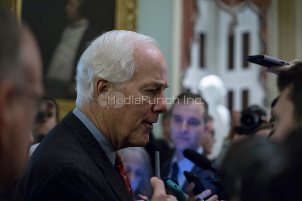United States Senate Majority Whip John Cornyn (Republican of Texas) speaks with reporters outside the US Senate chamber in the US Capitol in Washington, DC on Friday, December 1, 2017.  <br /> Credit: Alex Edelman / CNP /MediaPunch