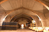 Wine aging in oak barrels. Modernista style vaulted winery. Raimat Costers del Segre Catalonia Spain