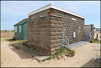 BNPS.co.uk (01202 558833)<br /> Pic: CorinMesser/BournemouthEcho/BNPS<br /> <br /> The toilet block situated directly behind the &pound;225,000 beach hut. <br /> <br /> Britain's most expensive beach hut has gone on the market for a whopping 225,000 pounds - and it doesn't even come with sea views.<br /> <br /> The wooden shack, that measures 13ft by 13ft, looks out onto sand dunes and offers  glimpses of the sea. It is also right next to a public toilet block.<br /> <br /> The timber hut on Mudeford Spit near Christchurch, Dorset, is divided up into three rooms - a living area, bedroom and a mezzanine level.<br /> <br /> It has no bathroom, mains electricity or running water and requires a ride on a novelty land train or a 30 minute walk to get there.