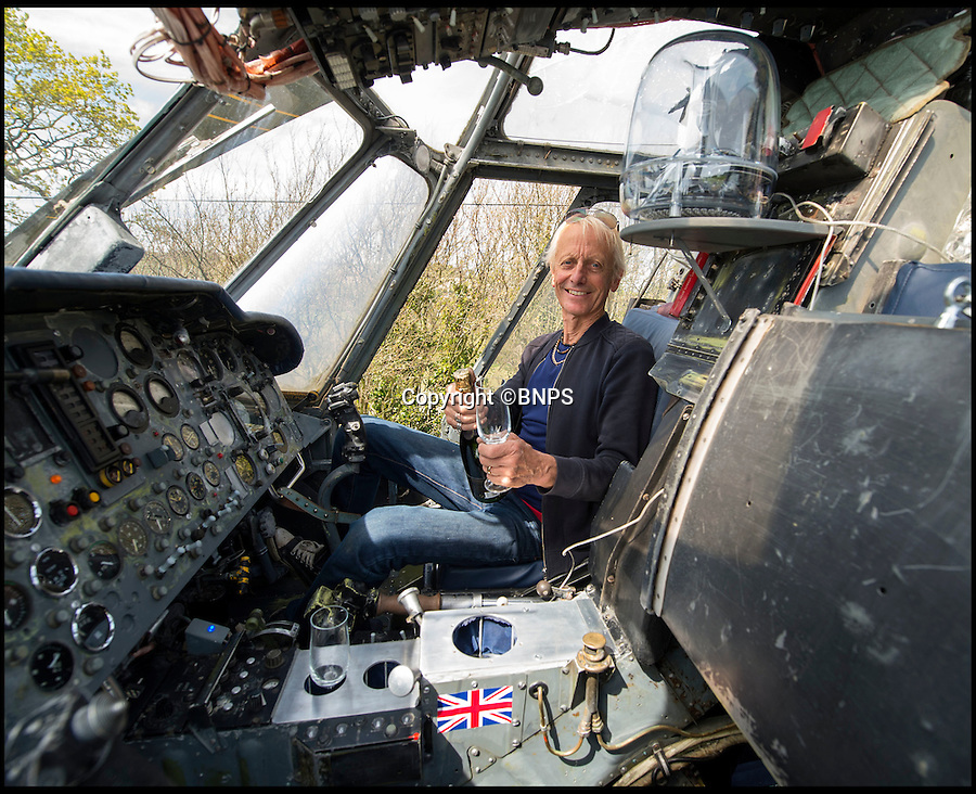 BNPS.co.uk (01202 558833)<br /> Pic: PhilYeomans/BNPS<br /> <br /> Ultimate Heli-pad for a holiday - Campsite owner Stewart Dungey is hoping his new venture takes off - after turning a decommissioned Royal Navy helicopter into a unique holiday let.<br /> <br /> Stewart has spent £30,000 buying, transporting and converting a Cold War Westland Wessex chopper on his farm on the Isle of Wight<br /> <br /> With an Airstream caravan kitchen annex one side and a bedroom pod on the other the chopper now provides luxury accomodation for adventurous families.