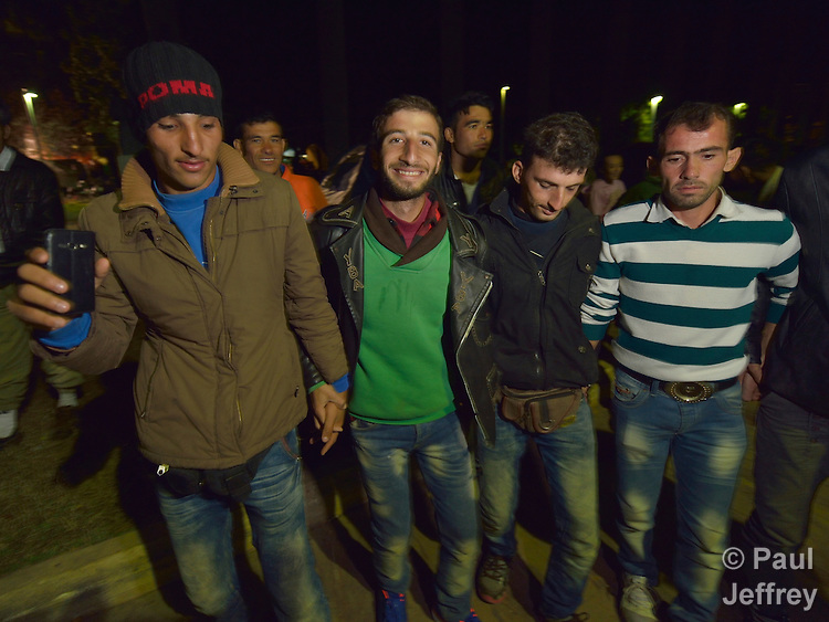 Refugees and migrants dance together at night in a city park on the Greek island of Chios. The park is full of tents sheltering refugees who crossed the Aegean Sea in small boats from Turkey. They were registered and provided with food and shelter in a reception center built with support from International Orthodox Christian Charities, a member of the ACT Alliance. Many of them then move to the city park where they await a ferry to take them to Athens and then on toward western Europe. Hundreds of thousands of refugees and migrants have passed through Greece in 2015.