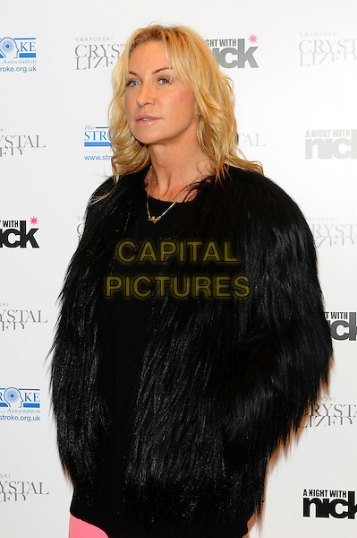 "Meg Matthews.The ""A Night With Nick"" charity event in aid of The Stroke Association, Swarovski CRYSTALLIZED, Gt. Marlborough St., London, England..December 6th, 2011.half length black fur jacket furry hands in pockets .CAP/CJ.©Chris Joseph/Capital Pictures."