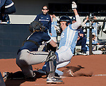 March 10, 2012:   San Diego Toreros Jessica Tieszen is tagged out at home by Nevada Wolf Pack catcher Ashley Butera during their NCAA softball game played as part of the The Wolf Pack Classic at Christina M. Hixson Softball Park on Saturday in Reno, Nevada.