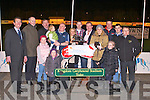 PRESENTATION: Denis Murphy presenting the winning trophy to Rita Doherty owner of Airforce Diva winner of the Gallivan-Murphy-Hooper-Dolan Classic Final at the Kingdom Greyhound Stadium on Friday l-r: Declan Dowling (sales and operational manager KGS), Brendan Moore (IGB), Roger Sheehy, Molly Cremin, Freya McKenna, Hannah Doherty, Keith Doherty, Rita Doherty, Seamus Moynihan, Denis Murphy, Sian McKenna, Kieran Casey (race manager KGS), Aliyah Mckenna, Damien Lonergan and Owen McKenna (trainer).