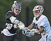 Luke Keating #4 of Garden City, left, snaps off a shot during the 131st Woodstick Classic against host Manhasset High School on Saturday, April 29, 2017. Manhasset won by a score of 10-8.