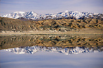 Snow-covered Montezuma Range reflected in the lithium evaporation ponds in Clayton Valley, Nev.