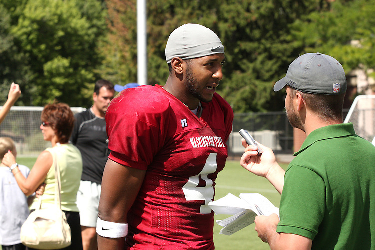 Brandon Gibson, standout senior wide receiver for the Washington State Cougar football team, talks with local media following practice during Fall Camp in Pullman, Washington, on August 11, 2008.