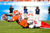 January 1, 2009:      Clemson wide receiver Aaron Kelly (80) stretches out for extra yardage on a pass play as Nebraska cornerback Armando Murillo (6) makes the tackle during the  64th annual Konica Minolta Gator Bowl between the Nebraska Cornhuskers  and the Clemson Tigers  at Jacksonville Municipal Stadium in Jacksonville, Florida. Nebraska defeated Clemson 26-21.