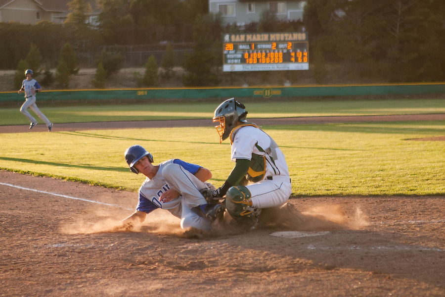 San Marin catcher Mitchell Ho tags Acalanes High's Zac Schoenrock in the top of the 10th inning of the North Coast Section Division 3 championship game.  The  umpires suspended the game after the 10 complete innings with the score 4-4. NCS officials later declared both teams Co-champions.