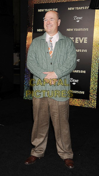 "Larry Miller.The World Premiere of ""New Year's Eve' held at The Grauman's Chinese Theatre in Hollywood, California, USA..December 5th, 2011.full length brown trousers green cardigan .CAP/ROT/TM.©Tony Michaels/Roth Stock/Capital Pictures"