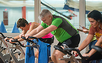 NWA Democrat-Gazette/BEN GOFF @NWABENGOFF<br /> Brandi Holt (from left) of Fayetteville, Shannon Skyrme of Fayetteville and Madeline Thornton of Van Buren bike Saturday, March 10, 2018, while competing in the 2018 Indoor Triathlon at the Jones Center in Springdale. Participants started in waves and had 10 minutes to swim, 20 minutes on a stationary bike and 15 minutes on a treadmill to log as many miles as possible.