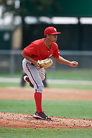 GCL Nationals relief pitcher Gilberto Chu (61) follows through on a pitch during the second game of a doubleheader against the GCL Marlins on July 23, 2017 at Roger Dean Stadium Complex in Jupiter, Florida.  GCL Nationals defeated the GCL Marlins 1-0 as Johnson combined with starting pitcher Jared Johnson (not pictured) to throw a seven inning no-hitter. (Mike Janes/Four Seam Images)