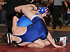Ben Tepperman of Hauppauge, back (face visible), tangles with Kyle Mock of Huntington at 120 pounds during the Suffolk County varsity wrestling Division I semifinals at Hofstra University on Sunday, February 15, 2015. Tepperman won the match by decision.<br /> <br /> James Escher