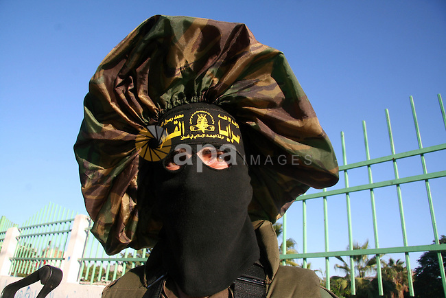 "Masked Palestinian members of the military wing of Islamic Jihad Brigades Jerusalem, ""Jerusalem Brigades"",  participate in a rally for the Islamic Jihad in the northern Gaza Strip."