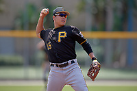 Pittsburgh Pirates third baseman Jung Ho Kang (15) warmup throw to first base in between innings during a Florida Instructional League game against the Toronto Blue Jays on September 20, 2018 at the Englebert Complex in Dunedin, Florida.  Kang is on rehab assignment after having surgery on his left wrist to remove cartilage.  (Mike Janes/Four Seam Images)
