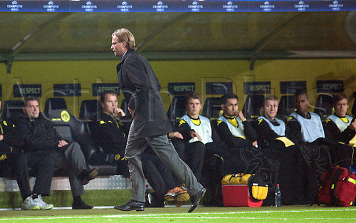 01.10.2011 Dortmund Germany.  Dortmund's coach JKlopp leaves the pitch at half time during the UEFA Champions League group F soccer match between Borussia Dortmund and Olympiacos Piraeus at the Signal-Iduna-Park stadium in Dortmund, Germany. Mandatory credit: ActionPlus