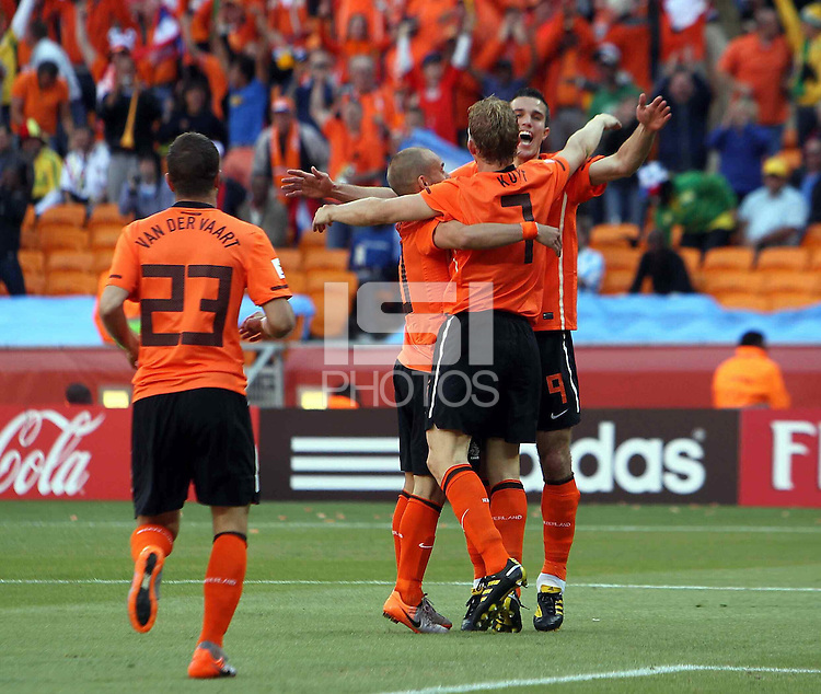 Robin van Persie (right) Dirk Kuyt and Wesley Sneijder of Holland celebrate the opening goal against Denmark.