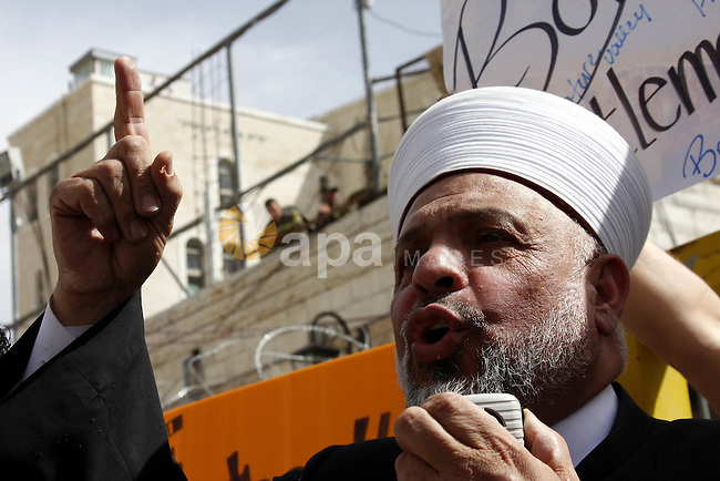 Palestinian Grand Mufti, Tayser Al-Tamimi takes part in a protest against Jewish settlements and Shuhada street closing near Beit Romano settlement in the city center of the West Bank city of Hebron on May 22, 2010. Photo by Mamoun Wazwaz