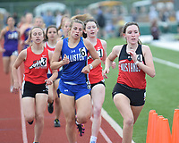 RICK PECK/SPECIAL TO MCDONALD COUNTY PRESS Ragan Wilson leads a pack of runners on her way to a second place in the 800 meter run at the Big 8 Conference Track and Field Championships held May 2 at Mount Vernon High School.