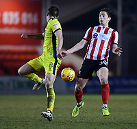 Lincoln City's Alex Woodyard vies for possession with Cheltenham Town's Kevin Dawson<br /> <br /> Photographer Chris Vaughan/CameraSport<br /> <br /> The EFL Sky Bet League Two - Lincoln City v Cheltenham Town - Tuesday 13th February 2018 - Sincil Bank - Lincoln<br /> <br /> World Copyright &copy; 2018 CameraSport. All rights reserved. 43 Linden Ave. Countesthorpe. Leicester. England. LE8 5PG - Tel: +44 (0) 116 277 4147 - admin@camerasport.com - www.camerasport.com