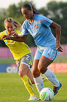 Rosana (11) of Sky Blue FC is marked by Heather Mitts (2) of the Philadelphia Independence. The Philadelphia Independence defeated Sky Blue FC 4-1 during a Women's Professional Soccer (WPS) match at Yurcak Field in Piscataway, NJ, on June 19, 2010.