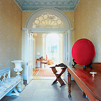 Light pours into a Georgian hallway highlighting superb plasterwork and a stunning interior fanlight.