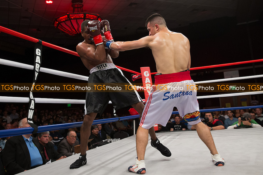 Francisco Santana defeats Leshon Sims in their junior middleweight bout - Central Coast Championship Night Boxing at the Chumash Casino Resort & Spa in Santa Ynez, California, promoted by Gary Shaw Promotions - 14/06/13 - MANDATORY CREDIT: Dwight McCann/TGSPHOTO - Self billing applies where appropriate - 0845 094 6026 - contact@tgsphoto.co.uk - NO UNPAID USE