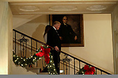 United States President Donald J. Trump and First Lady Melania Trump descend the Grand Staircase in front of the portrait of US President Harry S Truman as they arrive at the Congressional Ball at White House in Washington on December 15, 2018. <br /> Credit: Yuri Gripas / Pool via CNP