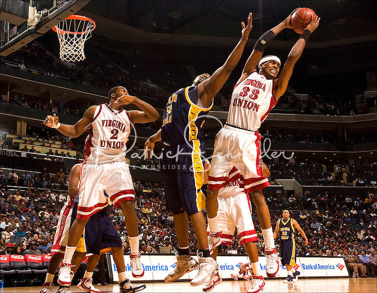 A basketball player pulls down a rebound during the CIAA Tournament  in Charlotte, NC.