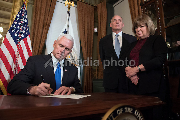 Retired Marine General James Kelly is sworn-in as Secretary of Homeland Security by Vice President Mike Pence, as his wife Karen holds the bible, in the Vice Presidential ceremonial office in the Executive Office Building in Washington, D.C. on January 20, 2017. Photo Credit: Kevin Dietsch/CNP/AdMedia