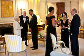 President Barack Obama and First Lady Michelle Obama talk with Queen Elizabeth II, Prince Philip, Duke of Edinburgh, Ambassador Louis Susman, and Mrs. Margaret Susman before a dinner in the Queen's honor at Winfield House in London, England, May 25, 2011..Mandatory Credit: Pete Souza - White House via CNP