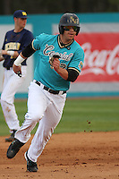Daniel Bowman #26 of the Coastal Carolina University Chanticleers running in a game against the University of Michigan Wolverines at the Carvelle Resort Classic Tournament held at Watson Stadium at Vrooman Field in Conway,, SC on March 13, 2010. Photo by Robert Gurganus/Four Seam Images