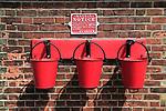 Heritage steam railway, Sheringham station, North Norfolk Railway, England, UK red fire water buckets