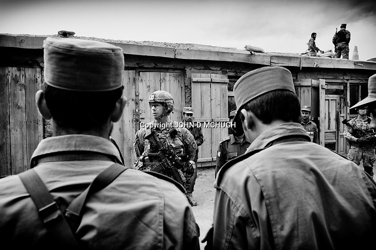 US Army Lieutenant Colonel Dan Wilson (2L), Battalion Commander of 2/27 Infantry, 25th Infantry Division, addresses young recruits at an Afghan National Police checkpoint in Nishigam in northern Kunar, 05 December 2011. (John D McHugh)