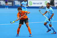 Azri Hassan of Malaysia controls the ball during the Hockey World League Quarter-Final match between India and Malaysia at the Olympic Park, London, England on 22 June 2017. Photo by Steve McCarthy.