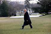 United States President Donald J. Trump walks on the South Lawn of the White House in Washington before his departure for the Republican National Committee Winter Meeting in Miami, Florida on January 23, 2020. <br /> Credit: Yuri Gripas / Pool via CNP