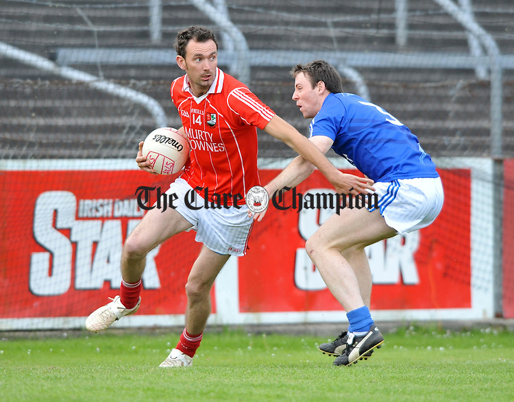 John Paul O Neill of Shannon Gaels in action against Barry Duggan of Cratloe during their game at Cusack Park. Photograph by John Kelly.