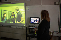 Sandra Haupt leads Senior students in a lesson using an MIT Blossoms video about exponential growth in her Intro to Calc class at Concord-Carlisle Regional High School in Concord, MA, USA. The class has partnered with MIT Blossoms to use video education tools in conjunction with regular lessons to reinforce key concepts.