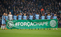 The teams (Man City pictured) stand for a minutes silence in memory of the plane crash in Columbia carrying some of Brazil's Chapecoense football team ahead of the UEFA Champions League GROUP match between Manchester City and Celtic at the Etihad Stadium, Manchester, England on 6 December 2016. Photo by Andy Rowland.