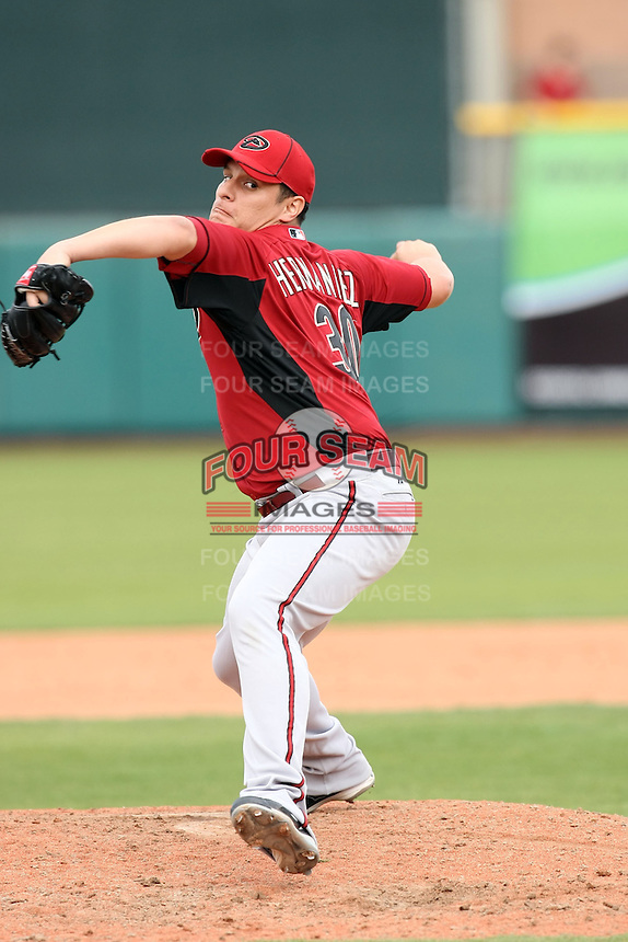 David Hernandez #30 of the Arizona Diamondbacks pitches against the San Francisco Giants in the first spring training game of the season at Scottsdale Stadium on February 25, 2011  in Scottsdale, Arizona. .Photo by:  Bill Mitchell/Four Seam Images.