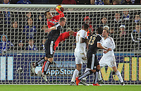 Lukasz Fabianski of Swansea (L) grabs the ball while Robert Huth of Leicester City pushes him over during the Barclays Premier League match between Swansea City and Leicester City at the Liberty Stadium, Swansea on December 05 2015