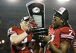 Wisconsin Badgers full back Bradie Ewing passes the Leaders Division Trophy to defensive back Aaron Henry (7) after an NCAA Big Ten Conference college football game against the Penn State Nittany Lions on November 26, 2011 in Madison, Wisconsin. The Badgers won 45-7. (Photo by David Stluka)