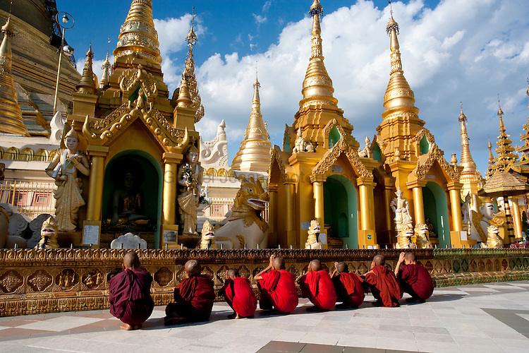 Buddhist monks praying at the buddhist temple in Yangon