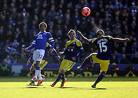 Pictured: Pablo Hernandez of Swansea (C) looks on as team mate Wayne Routledge heads the ball away. Sunday 16 February 2014<br />