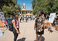 Cherena Walker, Hameetman Career Center talks with a student.<br /> 2018 InternLA student participants share their poster presentations about their summer experiences working as interns in Los Angeles. Summer Experience Expo, Sept. 13, 2018 in the Academic Quad. Hosted by Career Services.<br /> (Photo by Marc Campos, Occidental College Photographer)