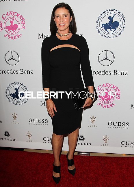 BEVERLY HILLS, CA, USA - OCTOBER 11: Mimi Rogers arrives at the 2014 Carousel Of Hope Ball held at the Beverly Hilton Hotel on October 11, 2014 in Beverly Hills, California, United States. (Photo by Celebrity Monitor)
