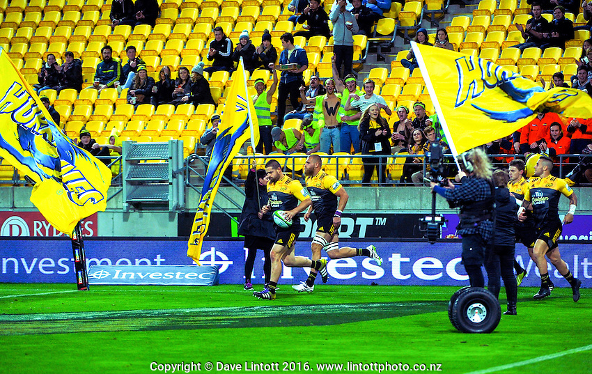 Dane Coles leads the Hurricanes out for the Super Rugby match between the Hurricanes and Reds at Westpac Stadium, Wellington, New Zealand on Saturday, 14 May 2016. Photo: Dave Lintott / lintottphoto.co.nz