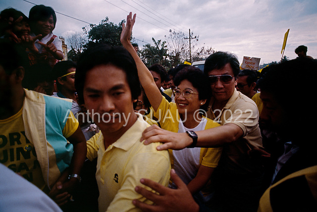 Manila, Philippines<br /> February 1986<br /> <br /> Corazon Aquino campaigning for President of the Philippines in 1986.<br /> <br /> Corazon Aquino was born into one of the wealthiest families in the Philippines, Mrs. Aquino began her political education by playing the dutiful wife as the political career of her husband, Benigno Aquino Jr., expanded. In less than 20 years he emerged as one of the chief potential rivals of Mr. Marcos, who was then president. When Mr. Marcos declared martial law in 1972, her husband was arrested and imprisoned for seven years. He was assassinated in 1983 after returning to the Philippines from a three-year exile in the United States. Mr. Marcos was widely blamed for the murder. It was at Mr. Aquino's funeral that Mrs. Aquino, became a national symbol, demonstrating the dignity and composure that would characterize her most difficult moments as president. <br /> <br /> Mrs. Aquino came to power through what amounted to popular acclaim -- what the Philippino people called &quot;people power&quot; -- expressed by huge crowds that gathered in support of her. Her popularity reached its peak during her presidential campaign against Mr. Marcos in January 1986, when she was surrounded by enthusiastic crowds chanting, &quot;Cory! Cory! Cory!'&quot;<br /> <br /> Her act of knocking down a dictator and bringing democracy to the Philippines was a high point in the country's modern history, and it offered a model for nonviolent uprisings that has been repeated often in other countries.<br /> <br /> Mrs. Aquino, was often criticized as an indecisive and ineffectual leader. But she combined passivity and stubbornness and an unexpected shrewdness to hold firm against powerful opponents from both the right and the left, and one of her greatest accomplishments as president was fending off a half dozen coup attempts. <br /> <br /> The restoration of democracy, and the transition to a new president, were Mrs. Aquino's prime legacies. Yet she led demonstrations against all 3 of her successors.<br /> <br /> She died on July 31, 2009.
