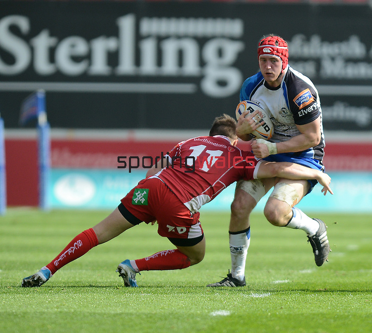 Connacht's Eoin McKeon is tackled by Scarlet's Jordan Williams<br /> <br /> Rugby - Scarlets V Connacht  - Rabodirect Pro12 - Sunday  30th March  2014 - Parc-y-Scarlets - Llanelli<br /> <br /> © www.sportingwales.com- PLEASE CREDIT IAN COOK