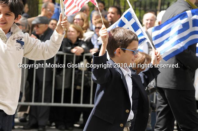 Greek Parade in New York City. Kids waving flags in the Greek Parade in New York City.